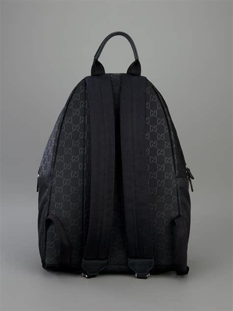 gucci embossed monogram backpack in black lyst