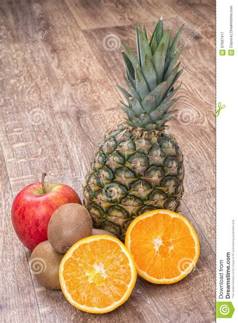 Hexagon Pineaple Apple Kiwi orange oranges pineapple kiwi and apple on a wooden background stock photo image 67697417