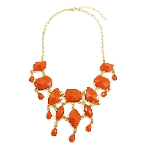 coral faceted geometric statement necklace