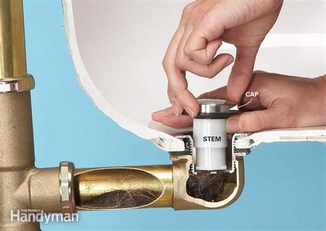 how to remove pop up bathtub drain unclog a bathtub drain without chemicals the family handyman