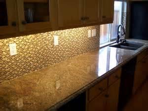 juparana tier kitchen with and tile backsplash