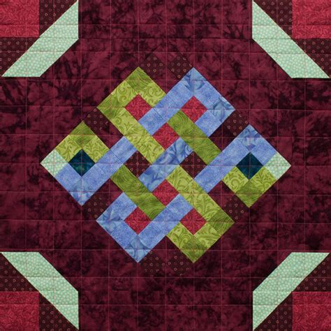 Patchwork Meaning - mosaic endless knot patchwork quilt block pattern