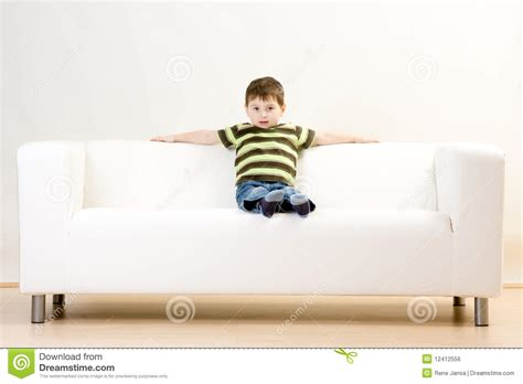 boy on couch boy sitting on couch royalty free stock image image