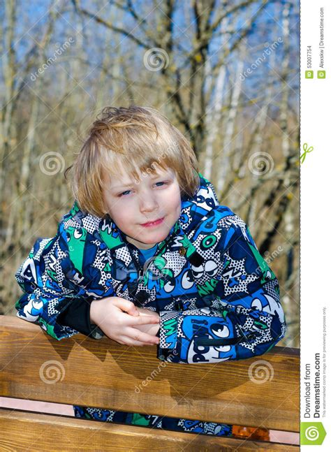 boys bench boy sitting on a bench royalty free stock photography