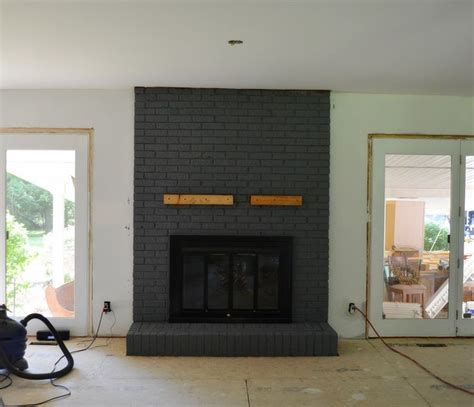 Black Painted Brick Fireplace by How To Paint Brick Fireplace In Your House After Paint