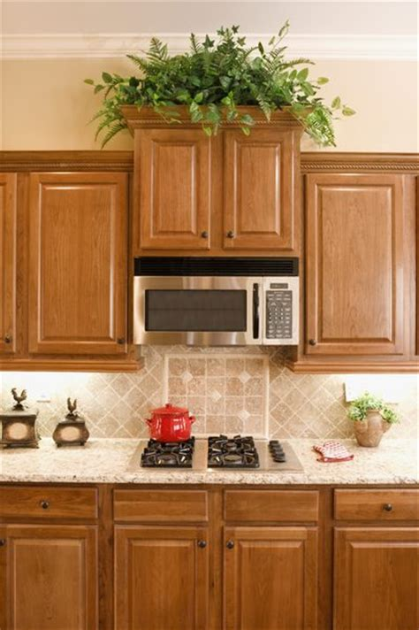 plants above kitchen cabinets how to decorate above your kitchen cabinets in 3 easy