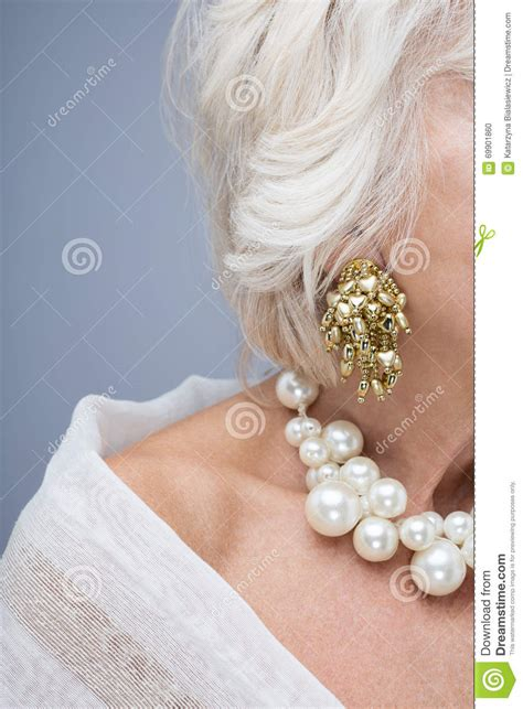 elegant mature woman wearing silver jewelry stock photo sophisticated jewelry for older woman stock photo image