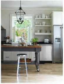 Adding casters to an antique table is a great way to lift it up to