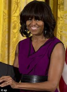 ms obamas new hair do i can finally see michelle obama debuts a new longer