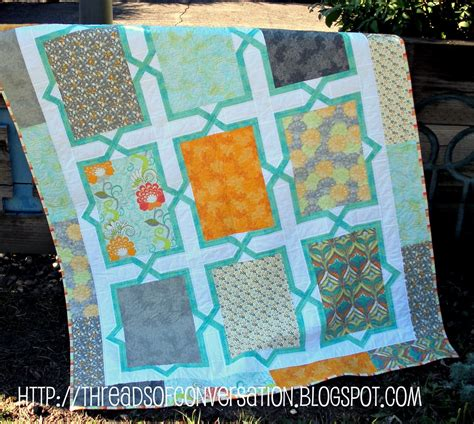 Say Pattern In Spanish | throw quilt made by a brunnette