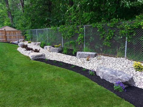 backdrop garden   river rock black beauty mulch