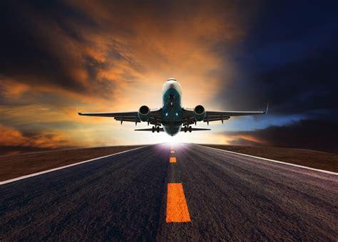 bid on flights passenger jet plane flying airport runway against