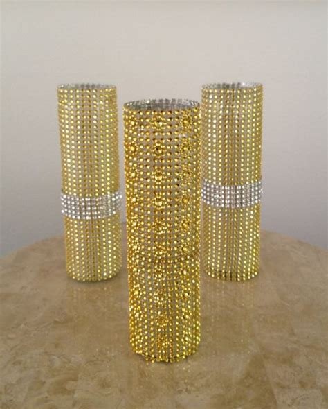 gold and silver bling vases.   Glamorous Weddings
