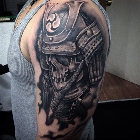 legion tattoo black ink scary skull on left shoulder