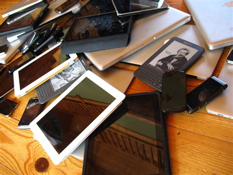 smart mobile device device pile laptop tablet phones the global dispatch