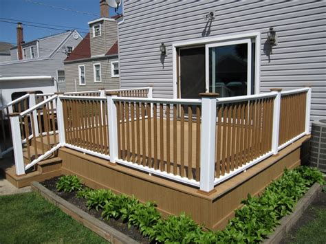 This outdoor deck has painted posts and rails