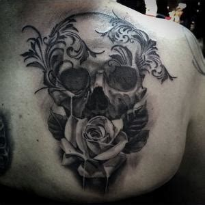 dying rose tattoo black and grey skull with roses