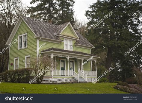 old fashioned house old fashioned farm house with a porch stock photo