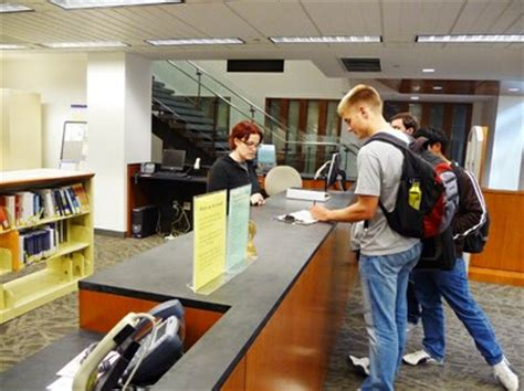 Foster Library Information Desk With Students Uw Libraries Student Information Desk