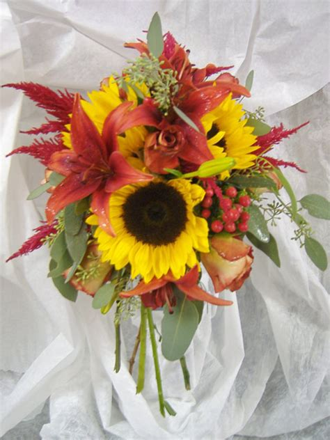 Bouquet Tiger clutch style bouquet in holder with sunflowers berry tiger seeded eucalyptus and