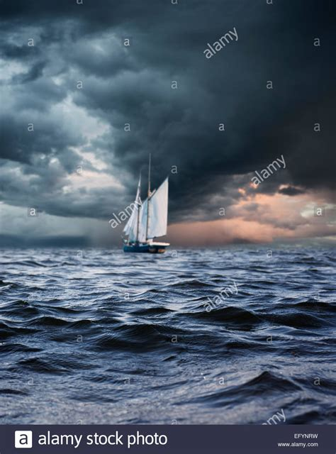sailing boat in a storm ship sailing in storm alone at sea conceptual image of