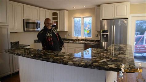 Kitchen Cabinets With Granite Countertops black mosaic gold granite installation by granite grannies