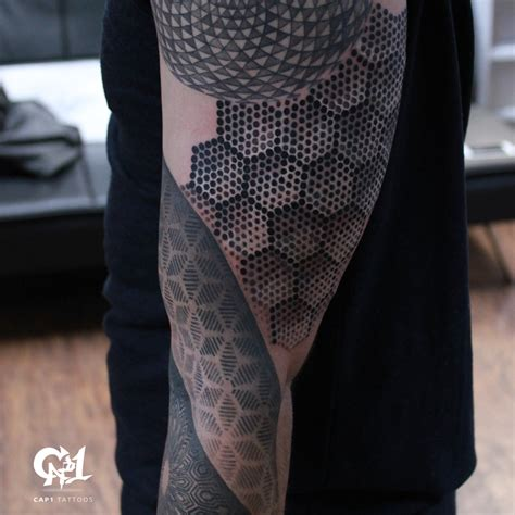 geometric sleeve tattoo by capone tattoos
