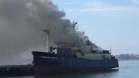 fishing boat on fire in san diego stubborn fire rips through ship sends thick smoke over