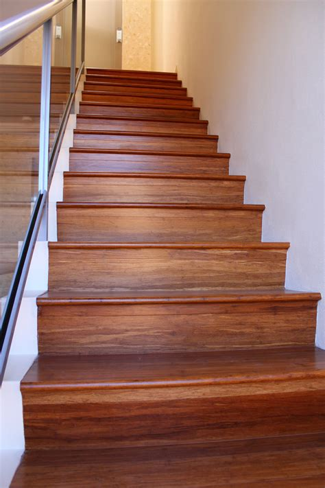 vinyl wood plank flooring on stairs with glass railings