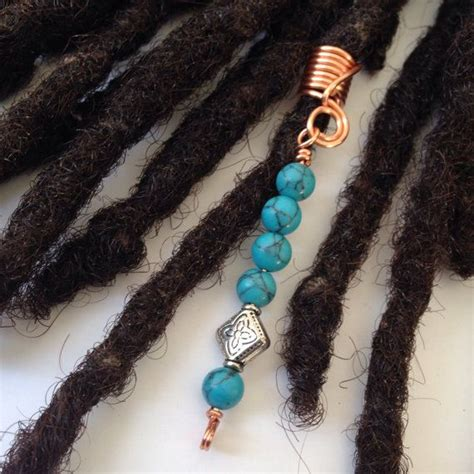 pictures of twisting braids made with dread attachment on bella naija 1000 images about hair jewelry for locs dreadlock