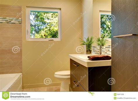 yellow and brown bathroom beige modern new bathroom with brown wood cabinets and tub