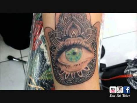 eye tattoo in london paco art tattoo london hamsa hand with eye tattoo