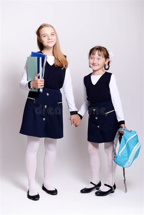school girl uniform stock photos pictures royalty free young schoolgirls stock photo image of beautiful book
