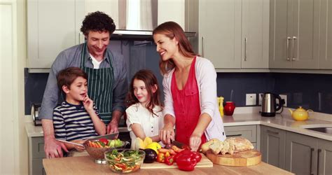 family in kitchen family in kitchen together dolly movement stock footage