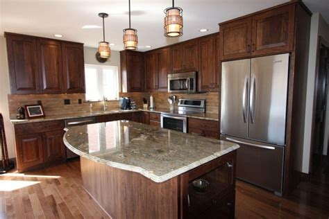 earth tone kitchen remodeled with walnut cabinetry