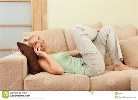 lying on a sofa woman lying on sofa royalty free stock photography image