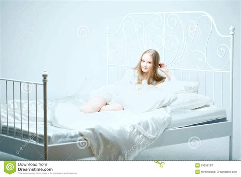 lying on bed girl lying on the bed royalty free stock photography