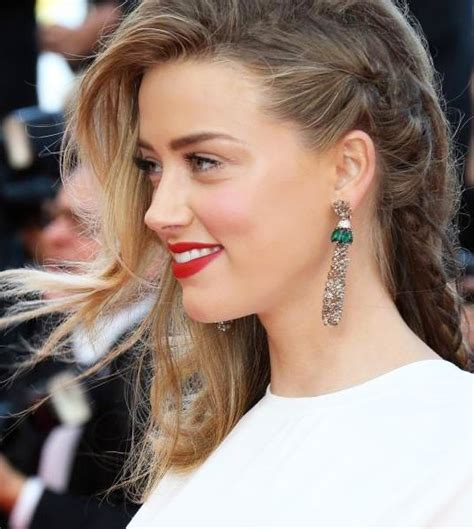 hairstyles braided on one side amber heard in one side braid with free natural curls on