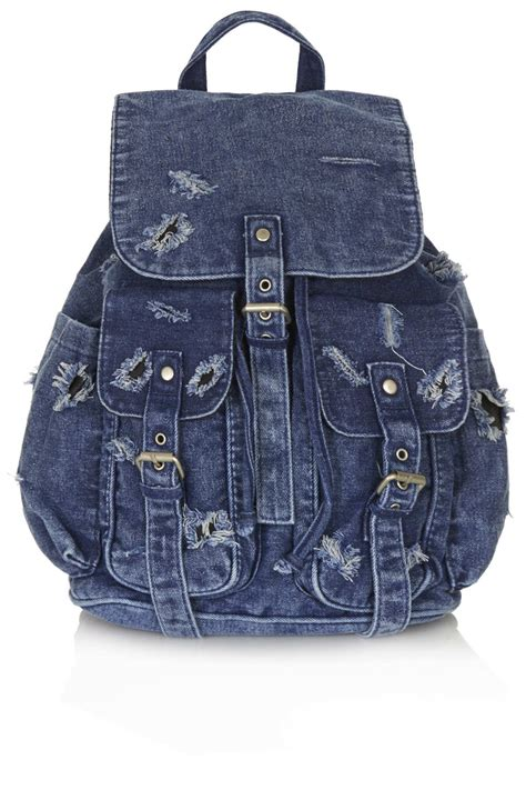 Denim Backpack topshop ripped denim backpack in blue lyst