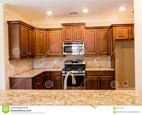 new kitchen cabinets and countertops dark wood cabinets and granite countertops stock photo
