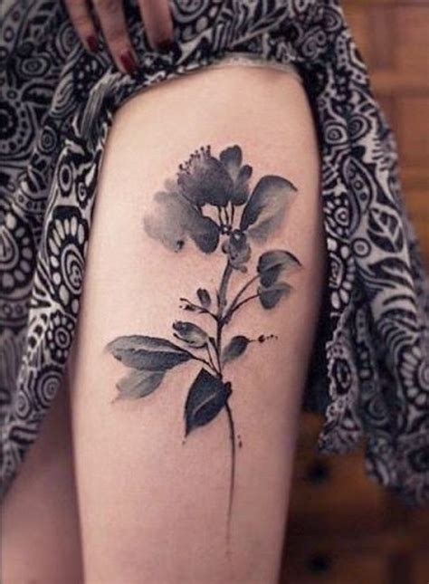 black women tattoos black grey watercolor flower on thigh for