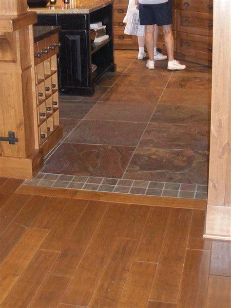 floor transitioning kitchen to livingroom   RE