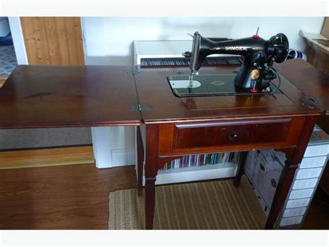 singer sewing machine in wooden cabinet sault ste