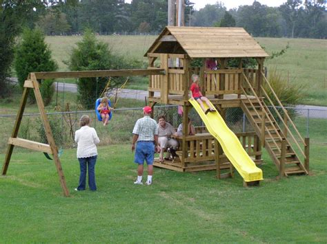 wooden playhouse with swing wooden swing set playhouse plans woodideas