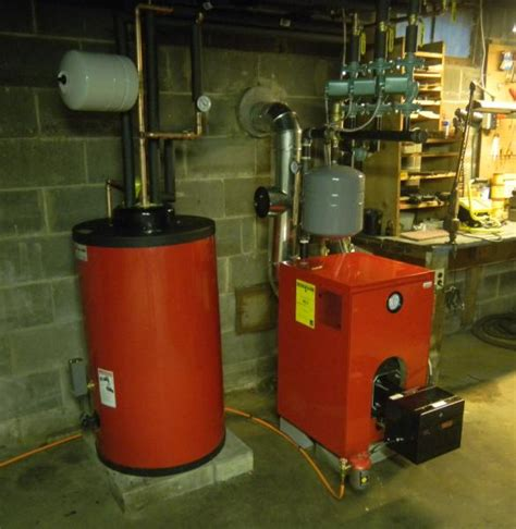 old hot water boiler replaced old tankless boiler with indirect 3 pass boiler