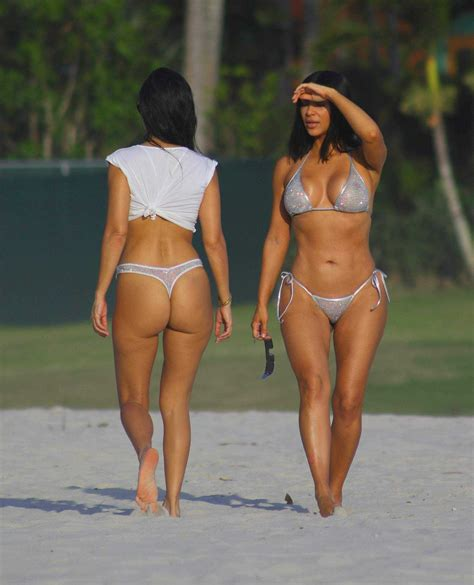 kim kardashian and kourtney kardashian in bikini at the beach in mexico   sawfirst hot