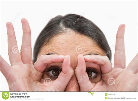 around her finger blogspotcom a woman with her fingers around her eyes royalty free