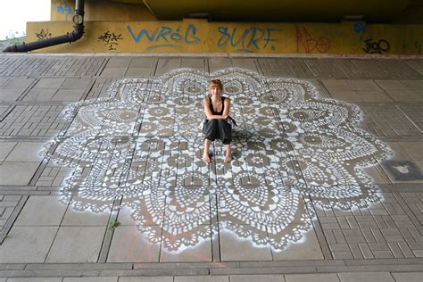 Pattern Street Art | polish artist covers city streets in intricate lace patterns