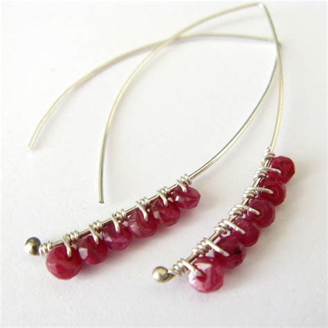 Handcrafted Earrings - ruby wrapped petals wire wrapped silver earrings