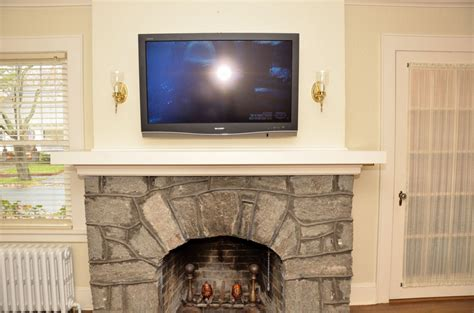 television over fireplace tv s and fireplaces chateau donoho